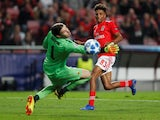 Benfica's Gedson Fernandes in action with AEK Athens' Vasilis Barkas during a Champions League match in December 2018