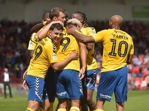 Charlton Athletic's Lyle Taylor celebrates scoring their first goal with teammates against Concaster on May 12, 2019