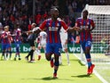 Crystal Palace's Michy Batshuayi celebrates scoring their second goal with Aaron Wan-Bissaka on May 12, 2019