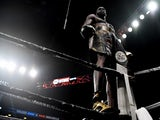 Deontay Wilder (bronze trunks) celebrates moments after defeating Dominic Breazeale by knockout in the first round of their world heavyweight championship boxing match at Barclays Center on May 19, 2019