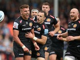 Exeter Chiefs' Henry Slade celebrates scoring their first try with team mates on May 18, 2019