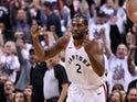 Toronto Raptors forward Kawhi Leonard (2) reacts after making a basket against the Philadelphia 76ers in game seven of the second round of the 2019 NBA Playoffs at Scotiabank Arena on May 13, 2019