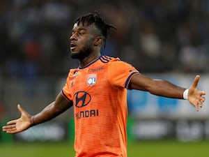 Lyon's Maxwel Cornet celebrates scoring their first goal against Marseille on May 12, 2019