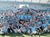 Manchester City players and staff celebrate winning the Premier League title on May 12, 2019