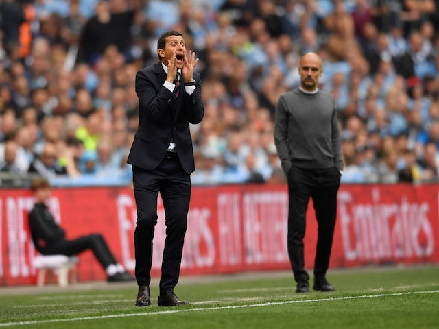 Watford manager Javi Gracia reacts as Manchester City manager Pep Guardiola looks on on May 18, 2019