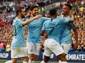 Manchester City players celebrate after their second goal against Watford in the FA Cup final on May 18, 2019