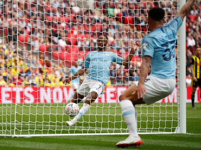 Manchester City's Raheem Sterling steals Gabriel Jesus's goal against Watford on May 18, 2019