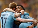 Manchester City's Gabriel Jesus celebrates scoring their fourth goal with Raheem Sterling and Kevin De Bruyne on May 18, 2019