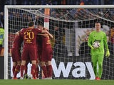 AS Roma's Edin Dzeko celebrates scoring their second goal with team mates as Juventus' Wojciech Szczesny looks on on May 12, 2019