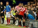 Sunderland's Luke O'Nien climbs out of the Portsmouth fans after falling in on May 16, 2019