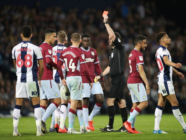 Chris Brunt is shown a red card in the second leg of the Championship playoff semi-final between West Bromwich Albion and Aston Villa on May 14, 2019