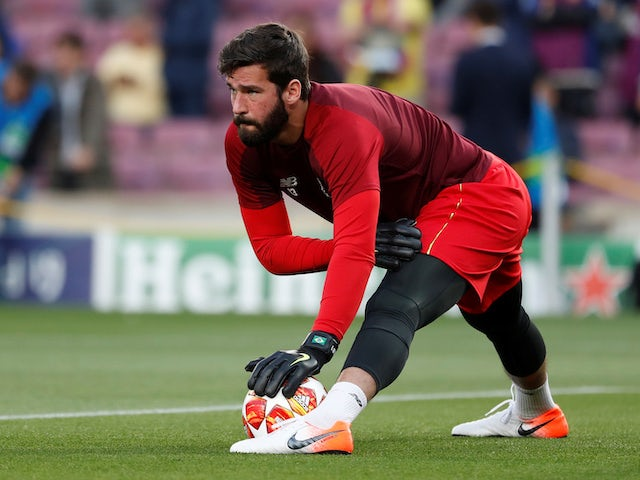 Alisson Becker warms up on May 1, 2019