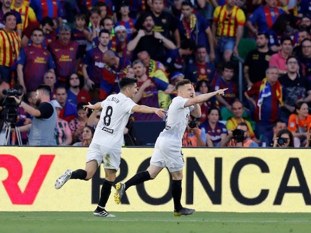 c52334912f4 Valencia s Kevin Gameiro celebrates scoring against Barcelona in the Copa  del Rey final on May 25
