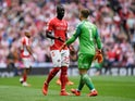 Charlton Athletic's Mahamadou-Naby Sarr talks with Dillon Phillips following the calamitous own goal against Sunderland in the League Two playoff final on May 26, 2019
