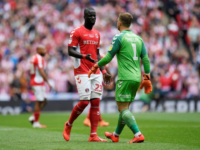 Charlton Athletic's Mahamadou-Naby Sarr talks with Dillon Phillips following the calamitous own goal against Sunderland in the League One playoff final on May 26, 2019