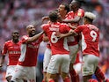 Patrick Bauer is mobbed by his Charlton Athletic teammates after scoring a late winner against Sunderland in the League One playoff final on May 26, 2019