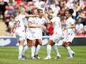 England's Nikita Parris celebrates scoring their first goal with team mates on May 25, 2019