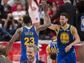 Golden State Warriors guard Klay Thompson (11) celebrates with forward Draymond Green (23) after Green scored a three-point basket in overtime against the Portland Trail Blazers in game four of the Western conference finals of the 2019 NBA Playoffs at Mod