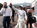Lewis Hamilton celebrates qualifying in pole position for the Monaco Grand Prix in May 25, 2019