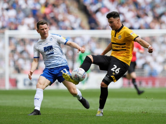 Newport County's Regan Poole in action with Tranmere Rovers' Connor Jennings in the League Two playoff final on May 25, 2019