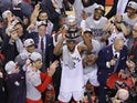 Toronto Raptors forward Kawhi Leonard (2) hoist the Eastern Conference trophy after winning game six of the Eastern conference finals of the 2019 NBA Playoffs against the Milwaukee Bucks at Scotiabank Arena on May 26, 2019