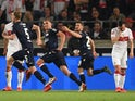 Union Berlin's Marvin Friedrich celebrates scoring their second goal with team mates as VfB Stuttgart's Gonzalo Castro looks dejected on May 23, 2019