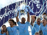 Manchester City captain Vincent Kompany lifts the 2018-19 Premier League trophy