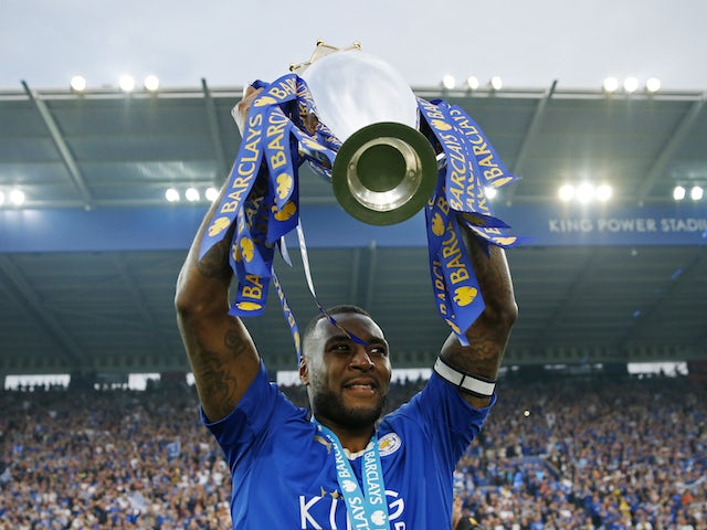 Leicester City's Wes Morgan lifts the Premier League trophy in May 2016
