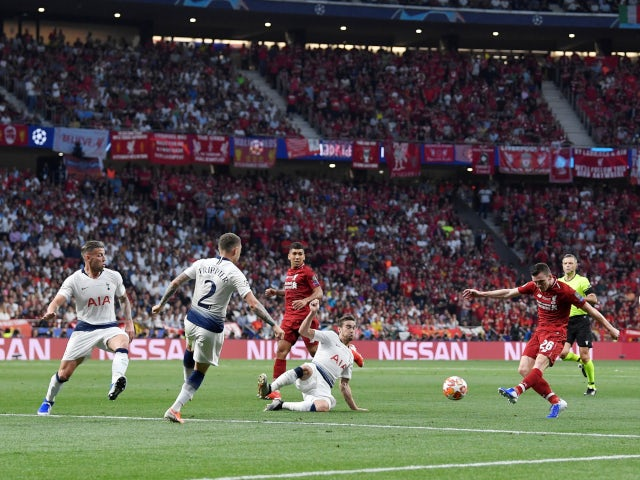 Andy Robertson has a shot kept out by Hugo Lloris during Liverpool's Champions League final showdown with Tottenham Hotspur on June 1, 2019