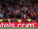 Divock Origi celebrates after scoring Liverpool's second goal in the Champions League final win over Tottenham Hotspur on June 1, 2019