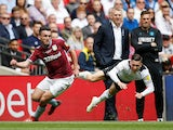 Aston Villa's John McGinn in action with Derby County's Harry Wilson as Villa boss Dean Smith looks on during the Championship playoff final on May 27, 2019