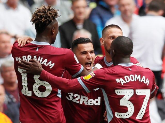 Anwar El Ghazi celebrates with his Aston Villa teammates after opening the scoring against Derby County in the Championship playoff final on May 27, 2019