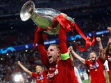 Liverpool captain Jordan Henderson lifts the Champions League trophy on June 1, 2019