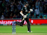 New Zealand's Mitchell Santner celebrates at the end of the match against Bangladesh on June 5, 2019