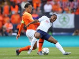 England attacker Raheem Sterling in action with Netherlands defender Virgil van Dijk in the UEFA Nations League semi-final on June 6, 2019