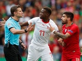Switzerland's Denis Zakaria and Portugal's Ruben Neves argue with the referee in the UEFA Nations League on June 5, 2019.