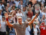 Roger Federer celebrates beating Stanislas Wawrinka at the French Open on May 4, 2019