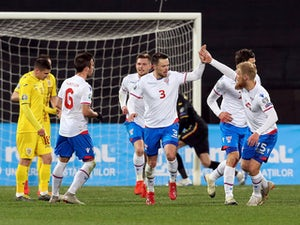 Faroe Islands defender Viljormur Davidsen celebrates scoring against Romania in March 2019