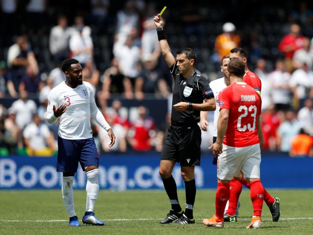 England's Danny Rose is booked during the UEFA Nations League third-place playoff against Switzerland on June 9, 2019.