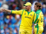 Australia's Aaron Finch speaks to Adam Zampa on June 9, 2019