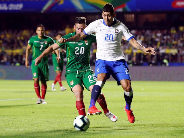 Brazil's Roberto Firmino in action with Bolivia's Fernando Saucedo in the Copa America on June 14, 2019