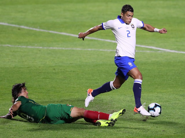Brazil's Thiago Silva in action with Bolivia's Marcelo Martins in the Copa America on June 14, 2019