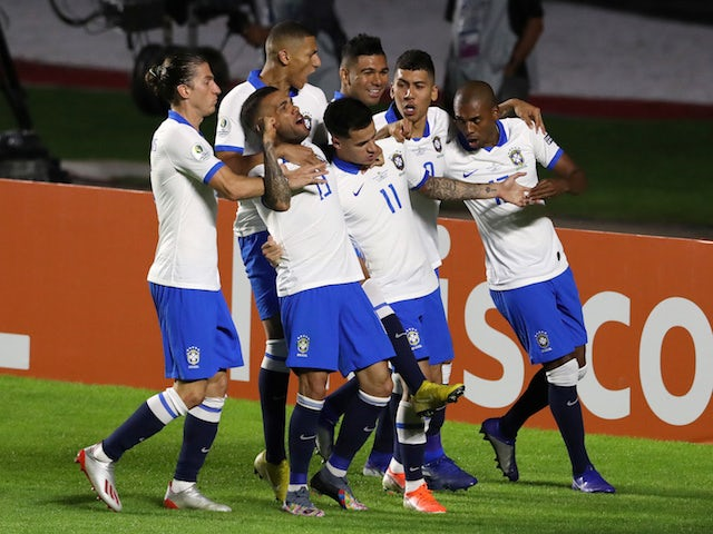 Brazil players celebrate Philippe Coutinho's first goal against Bolivia in the Copa America on June 14, 2019