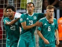 Germany's Leroy Sane celebrates scoring their first goal with Serge Gnabry and Joshua Kimmich on June 8, 2019