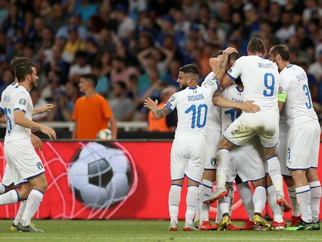 Italy's Leonardo Bonucci celebrates scoring their third goal with teammates against Greece on June 8, 2019