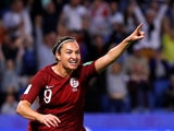 Jodie Taylor celebrates scoring for England on June 14, 2019