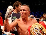 Josh Warrington celebrates retaining his belt on June 15, 2019
