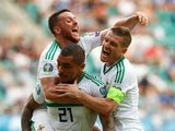 Northern Ireland's Josh Magennis celebrates scoring their second goal against Estonia with teammates on June 8, 2019