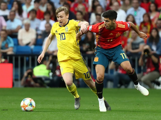 Spain's Marco Asensio in action with Sweden's Emil Forsberg in their Euro 2020 qualifier on June 10, 2019