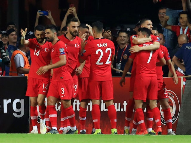 Turkey's Cengiz Under celebrates scoring their second goal against France with teammates on June 8, 2019